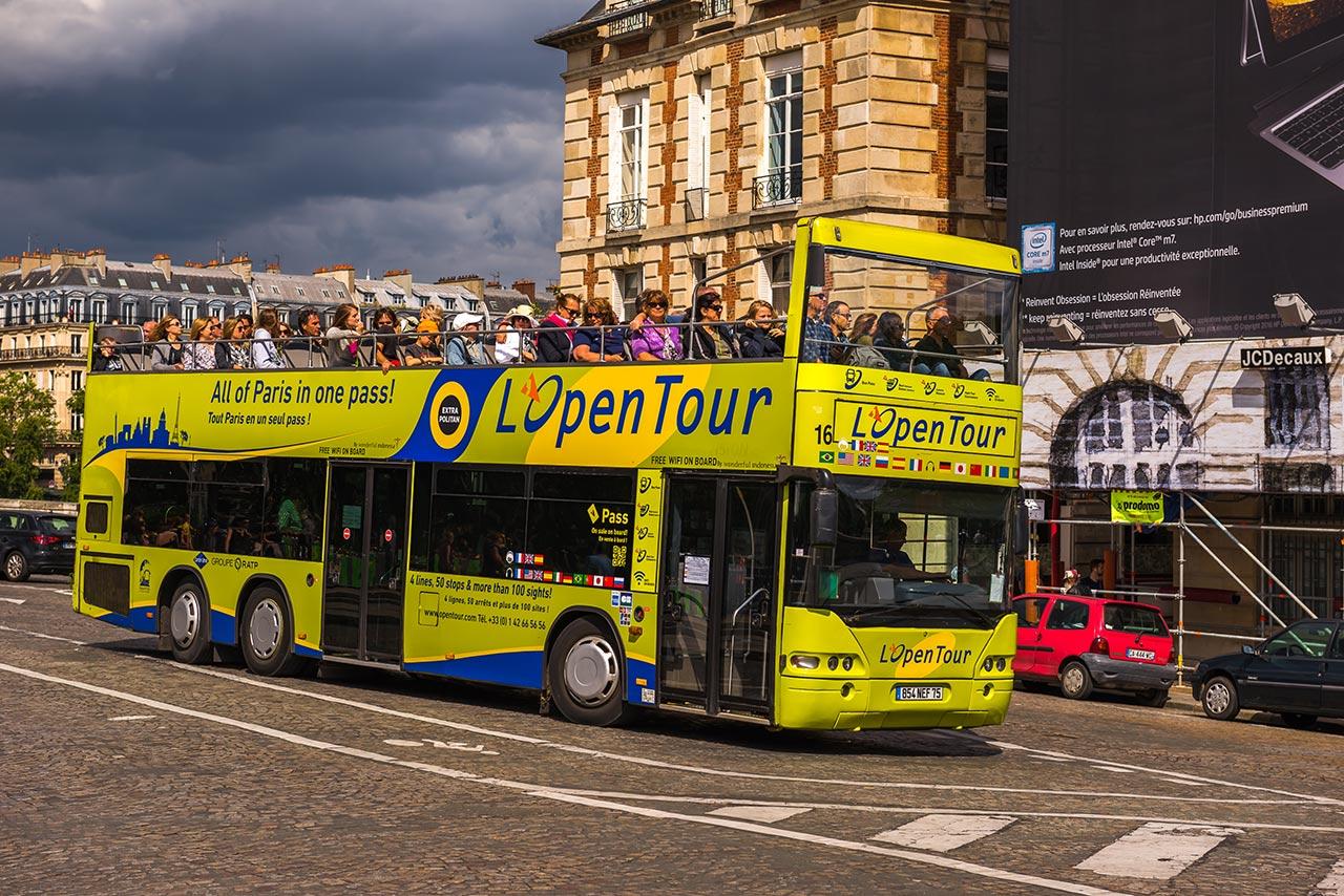 Ônibus para tour noturno em Paris